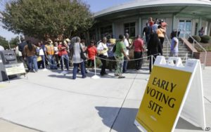 Voters line up during early voting at Chavis Community Center in Raleigh on Oct. 20. /AP