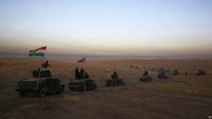 A Kurdish Peshmerga convoy heads toward the frontline east of Mosul on Oct. 17. /AP