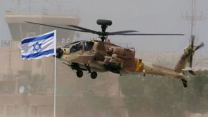A U.S.-origin Israel Air Force Apache Longbow helicopter. / Reuters