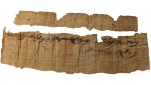 A First Temple-era, 2,700-year-old papyrus bearing the oldest known mention of Jerusalem in Hebrew.