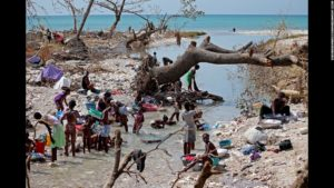 Haitians bathe and wash clothes in the aftermath of Hurrican Matthew. / CNN