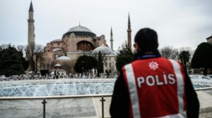 Turkish police officers stand guard at Sultanahmet in Istanbul. /AFP