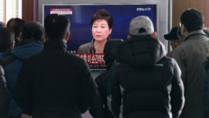 People watch a live broadcast of South Korean President Park Geun-hye addressing the nation at the Seoul Railway Station in Seoul on Nov. 29. /AP