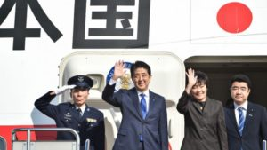 Japan's Prime Minister Shinzo Abe (pictured second left) and his wife Akie wave to well-wishers prior to boarding a plane at Tokyo's Haneda Airport on November 17. /AFP