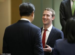 President Xi Jinping, left, talks with Facebook founder Mark Zuckerberg at a gathering of CEOs and other executives at Microsoft's Redmond campus on Sept. 23. /Getty Images