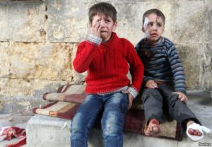 Injured boys react at a field hospital after airstrikes on the rebel held areas of Aleppo. /Reuters