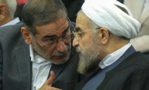 Secretary of Iran's Supreme National Security Council Ali Shamkhani (left) speaks with Iranian President Hassan Rouhani.