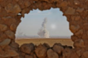 Smoke billows in the background as seen from the position of Syrian Democratic Forces in the village of Abu al-Ilaj on Nov. 7. /AFP