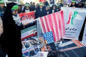 An Iranian youth burns home-made American flag outside the former U.S. embassy Teheran on Nov. 3. /AFP