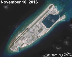 A satellite image shows what Asia Maritime Transparency Initiative says appears to be anti-aircraft guns and what are likely to be close-in weapons systems on the artificial island Fiery Cross Reef in the South China Sea in this image released on Dec. 13. /Courtesy CSIS Asia Maritime Transparency Initiative/DigitalGlobe/via Reuters