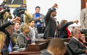 Democratic senators vote not to table an amendment to Senate Bill 4 during the North Carolina General Assembly's fifth special session on Dec. 21 in the Senate chambers in Raleigh. /AP