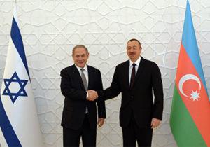 Israeli Prime Minister Benjamin Netanyahu (left) meets Azerbaijani President Ilham Aliyev in Baku. /Haim Zach/GPO