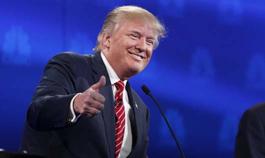 Republican U.S. presidential candidate businessman Donald Trump gives a thumbs up near the end of the 2016 U.S. Republican presidential candidates debate held by CNBC in Boulder