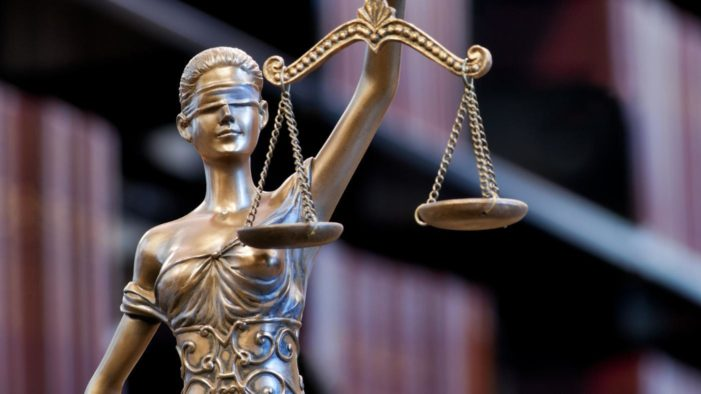 Swamp justice: The blindfolded lady peeks at party affiliation