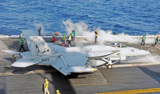 Russia warns it will target U.S. fighters after F-18 downs Syrian warplane