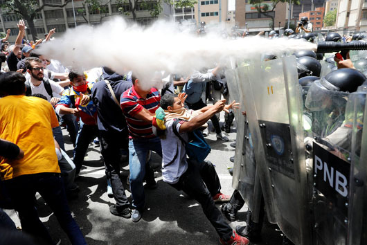 Venezuela on the brink: 'Chavez succeeded in creating an equal society by making everyone poor'