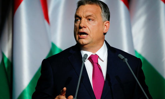 Hungary's leader credits border wall and Trump, condemns Soros 'mafia' and 'media they operate'