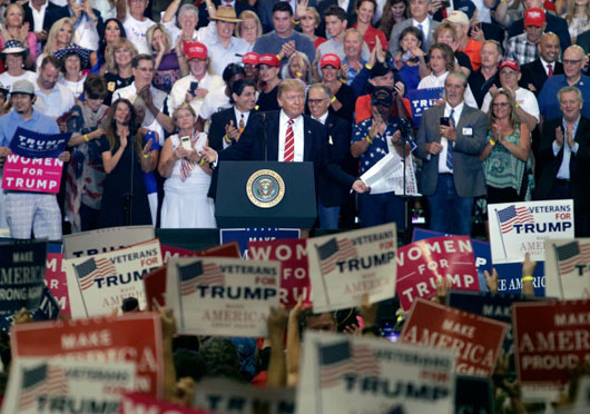 Trump slams media in Phoenix, vows to close the government to get funding for wall