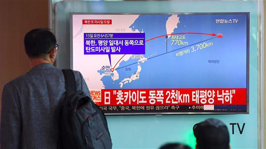 New, longest North Korea missile launch overflies Japan, puts Guam in range