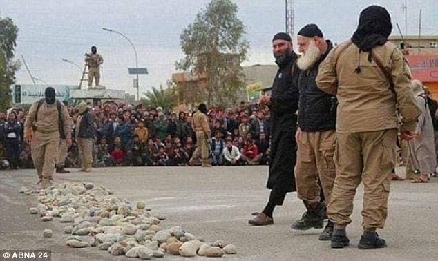 White-bearded ISIS executioner captured in Mosul where he was hiding
