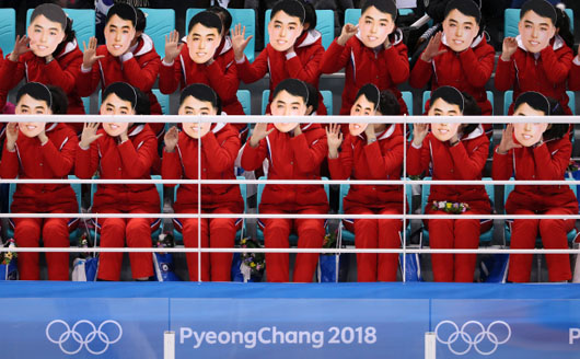 Olympics as N. Korea propaganda: Cheerleaders' Kim Il-Sung masks outrage S. Koreans