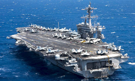 U.S. 'uneasy': China issues taunt as Vinson carrier group heads for South China Sea