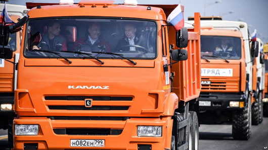 U.S. objects as Putin drives truck opening bridge to 'occupied Crimea'