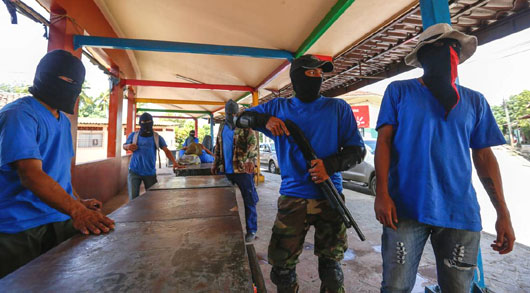 Rights group: Masked paramilitary rules Nicaraguan streets in 'undeclared state of siege'