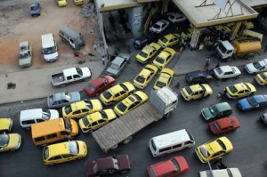 Palestinian drivers line up at a gas station in the West Bank city of Nablus.