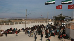 Syrians fleeing the northern embattled city of Aleppo wait at the Bab al-Salama crossing. /AFP