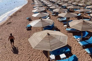 A tourist walks past sunbeds on a beach in Egypt's Red Sea resort of Sharm El-Sheikh on Nov. 10, 2015. /AFP/Getty Images