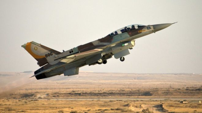 Israeli fighter jets strike arms convoy near northern border