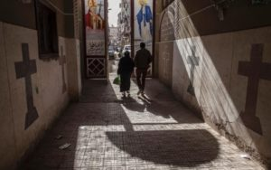 Coptic Christians walk outside St. Markos Church in Minya, where the attack took place. /Roger Anis
