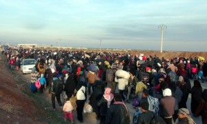 Syrian refugees flee air strikes in the northern city of Aleppo.