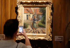 """Shepherdess Bringing in Sheep"" by Camille Pissarro, at the Fred Jones Jr. Museum of Art at the University of Oklahoma. /AP"
