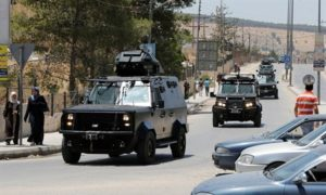 Jordanian security vehicles near the Baqa'a camp. /Reuters