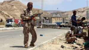 Yemeni troops guard a checkpoint in Mukalla. /AFP