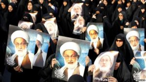 Protesters in Bahrain support Shi'ite cleric Ayatollah Isa Qassem during a 2013 demonstration. / Reuters