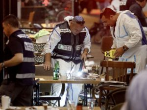 Israeli forensic police investigating the scene of a shooting at a shopping complex in the city of Tel Aviv on June 8. /AFP/Getty Images