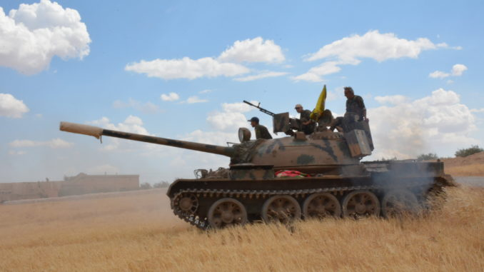 U.S.-backed Kurds, Russia-backed Syrians advance on Raqqa in pincer movement