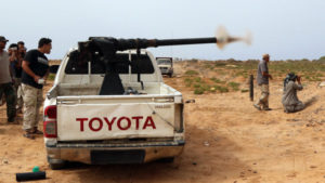 Forces loyal to Libya's UN-backed unity government fire during clashes with ISIL at the western entrance to Sirte. /Getty Images