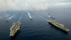 The US aircraft carriers John C. Stennis (L) and Ronald Reagan and other warships conduct drills in the Philippine Sea on June 18. /U.S. Navy photo