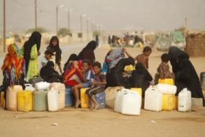 Women and children gather to collect water from a tap at a camp for displaced persons in al-Mazraq, Yemen. /Reuters