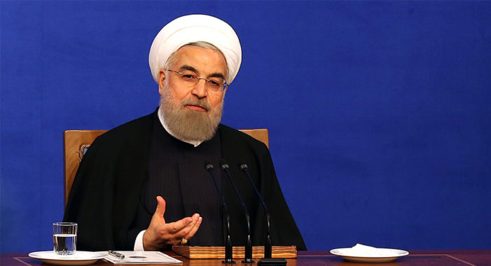 On eve of one-year anniversary of nuclear deal, Iran's Rouhani warns regime could restore program