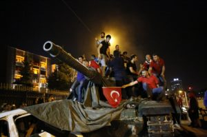 Pro-government protesters stand on a Turkish army tank in Ankara on July 16. /Reuters