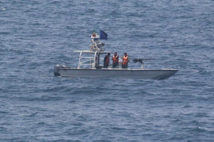 Iran speed boats buzz warship carrying top U.S. general through Strait of Hormuz