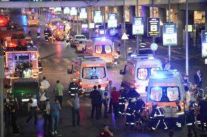 Paramedics help victims outside Istanbul's Ataturk Airport. /Reuters