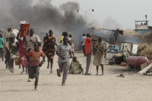 Refugees flee an attack on the United Nations-run Malakal Protection of Civilians site in South Sudan. /Getty Images