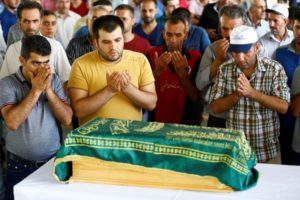 Family members of Sehriban Nurbay, a 3-month-old victim of a suicide bombing at a wedding in Gaziantep, attend her funeral ceremony in the southern Turkish city of Gaziantep, on Aug. 21. /Reuters