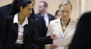 Huma Abedin and Hillary Clinton. /AP